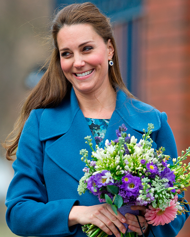 Catherine, Duchess of Cambridge, wearing a blue Max Mara coat, visits the Emma Bridgewater Pottery Factory in Stoke-on-Trent, 2015