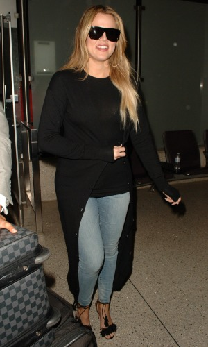 Khloe Kardashian arrives back on a flight from Armenia at Los Angeles International Airport (LAX) 14 April 2015