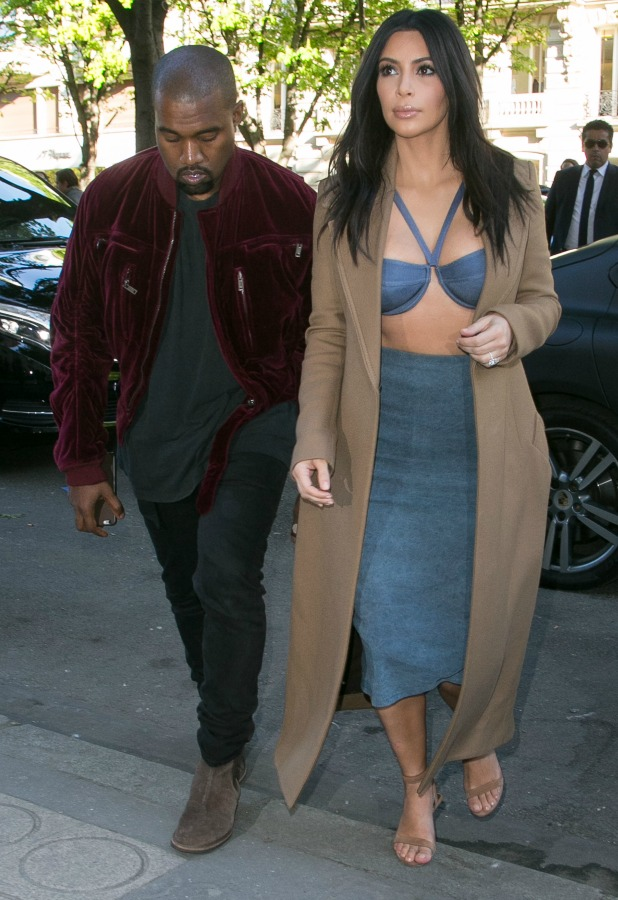 Kanye West and his wife Kim Kardashian West are seen arriving at the 'Montaigne Market' store on April 14, 2015 in Paris, France.