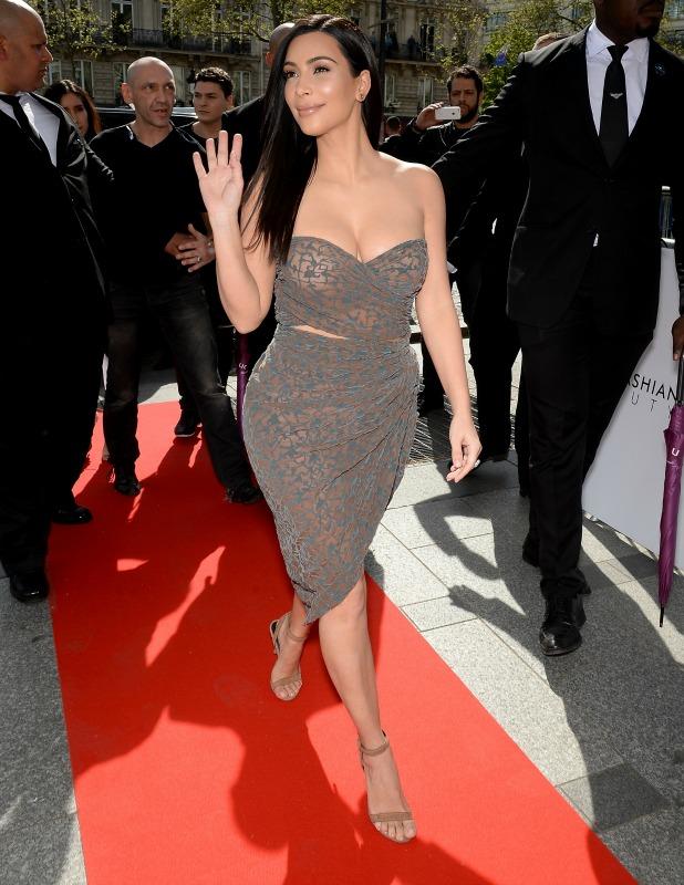 Kim Kardashian introduces 'Kardashian Beauty Hair' line at Marionnaud Champs Elysees on April 15, 2015 in Paris, France.