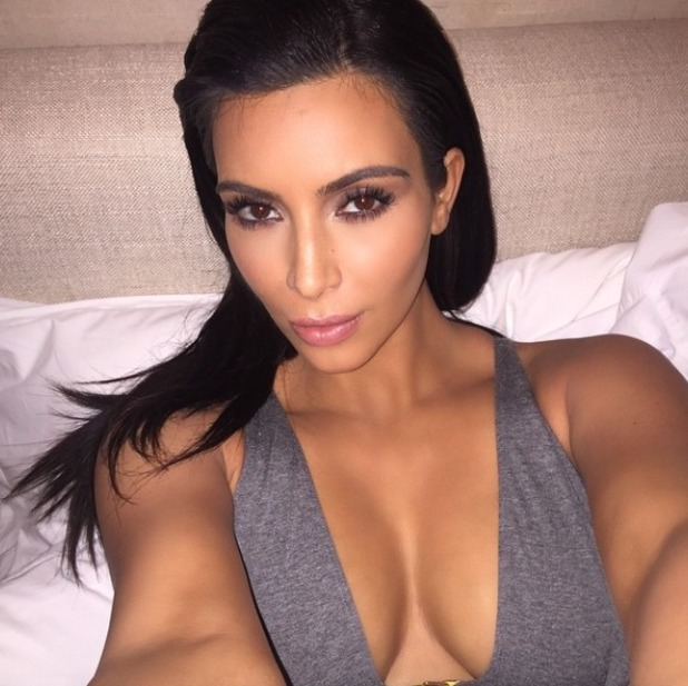 Kim Kardashian bed-time selfie before falling asleep in her make-up, 23 April 2015