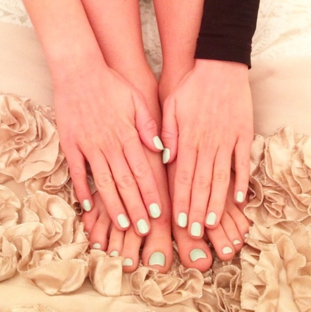 Lydia Bright shows off matching toe and fingernails for her holiday, 23 April 2015