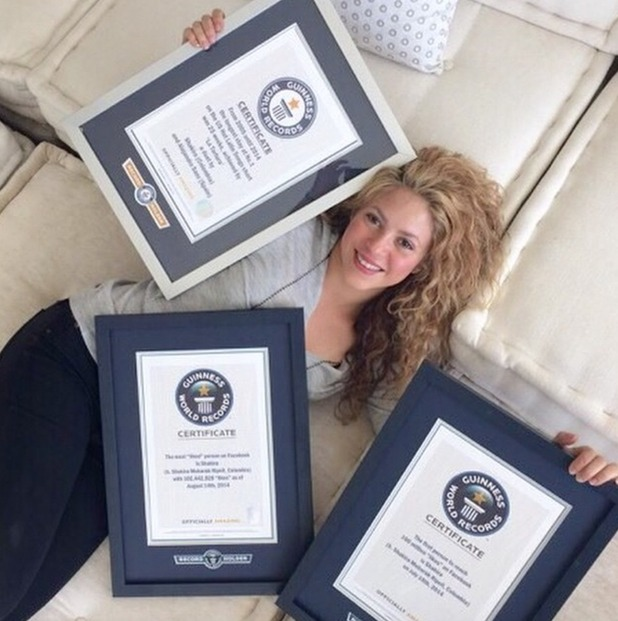 Shakira poses with her three Guinness World Records certificates after getting them framed - 20 April 2015.