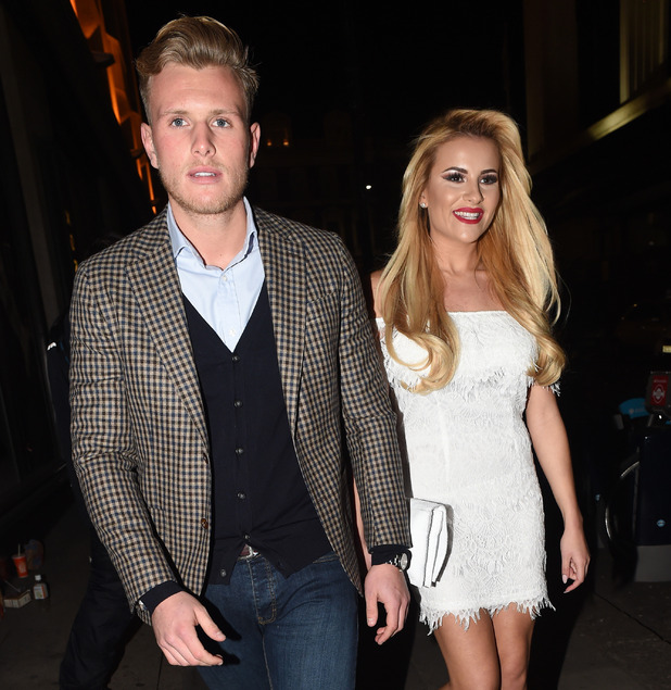 TOWIE's Tommy Mallet and Georgia Kousoulou leave the Jog On To Cancer charity bash held at Kensington Roof Gardens - 9 April 2015.