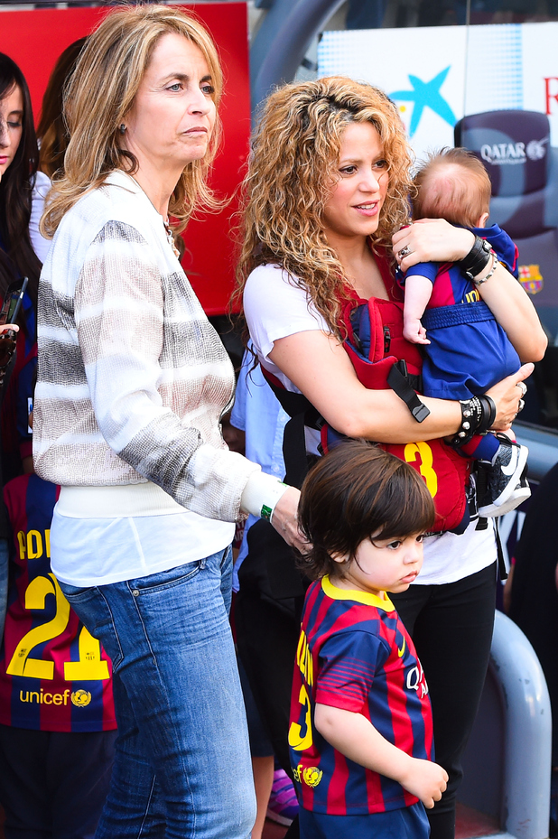 Shakira carries her son Sasha next to her mother in law Montserrart Bernabeu and her son Milan prior to the La Liga match between FC Barcelona and Valencia CF at Camp Nou on April 18, 2015 in Barcelona, Spain.