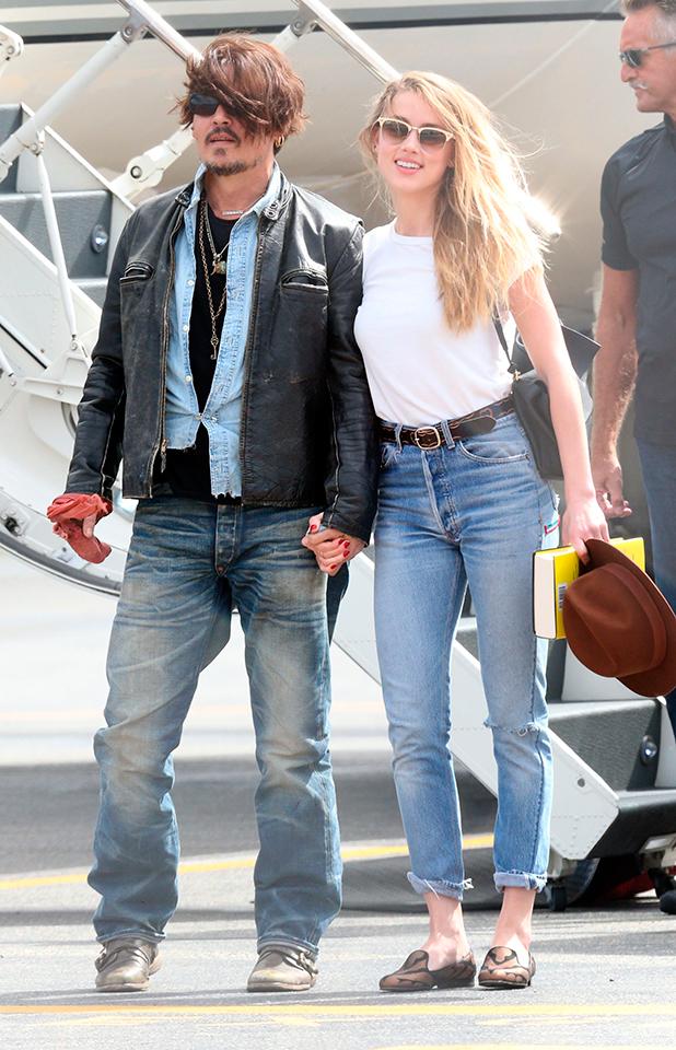 Johnny Depp and Amber Heard arrive at Brisbane Airport, Australia - 21 Apr 2015
