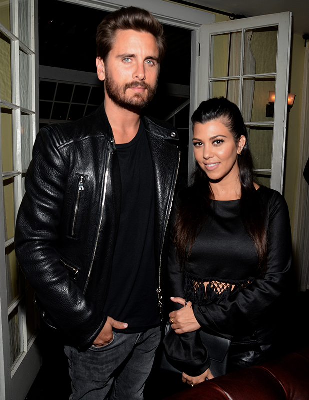 Scott Disick (L) and Kourtney Kardashian attend Opening Ceremony and Calvin Klein Jeans' celebration launch of the #mycalvins Denim Series with special guest Kendall Jenner at Chateau Marmont on April 23, 2015 in Los Angeles, California.