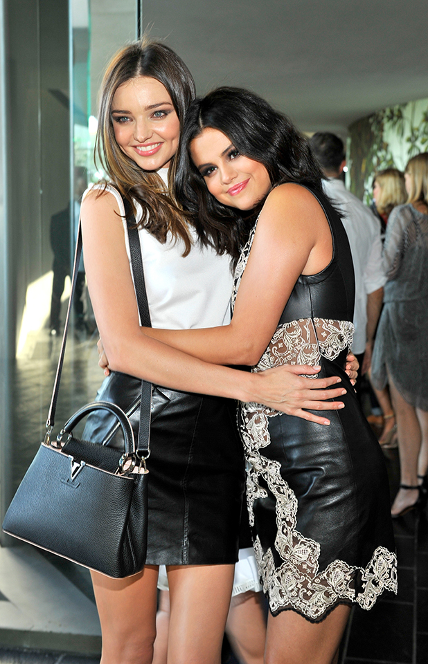 Model Miranda Kerr (L) and actress/singer Selena Gomez attend the Louis Vuitton Cruise 2016 Resort Collection shown at a private residence on May 6, 2015 in Palm Springs, California.
