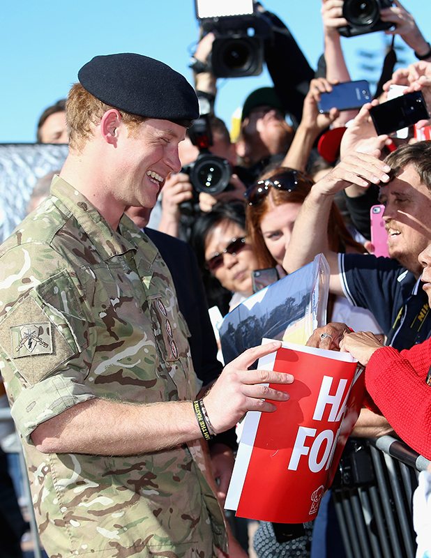 Prince Harry meets members of the public during a walkabout outside the Sydney Opera House on May 7, 2015 in Sydney, Australia. Prince Harry is visiting Sydney following a month-long deployment with the Australian Army.