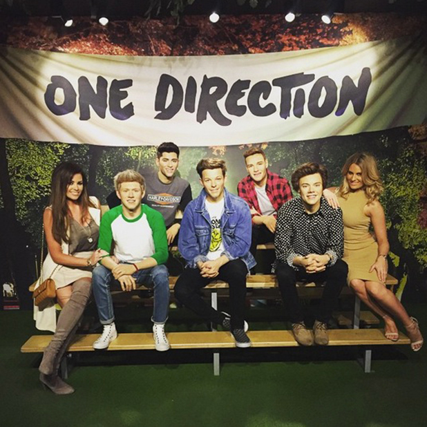 Jessica Wright and Dani Armstrong pose with One Direction waxworks, May 2015