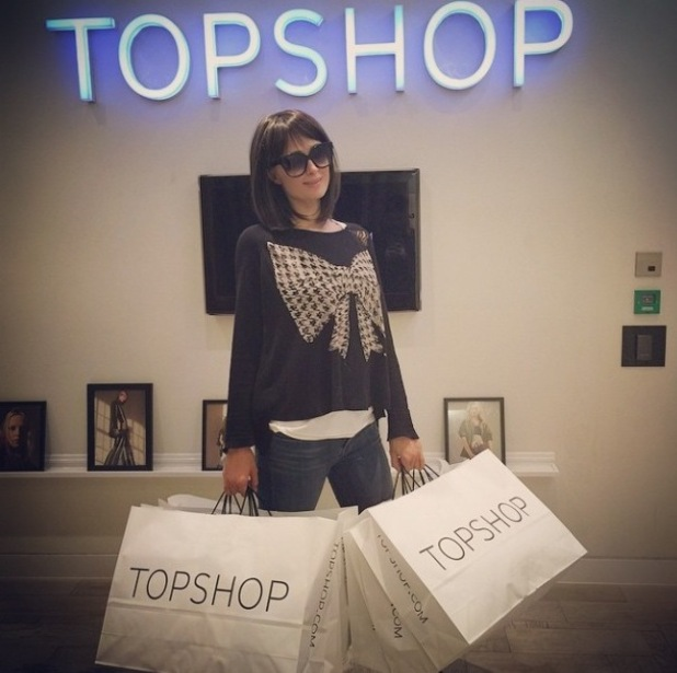 Paris Hilton goes undercover shopping in wig and sunglasses at Topshop in London - 13 May 2015.