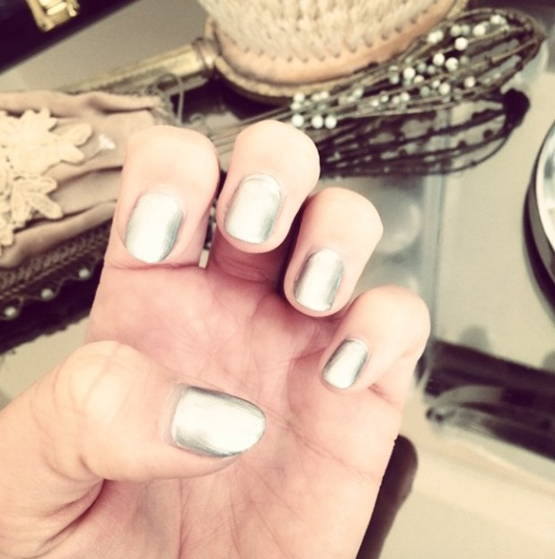 Lydia Bright shows off silver nails before attending the House of Fraser British Academy (BAFTA) Television Awards, 10 May 2015