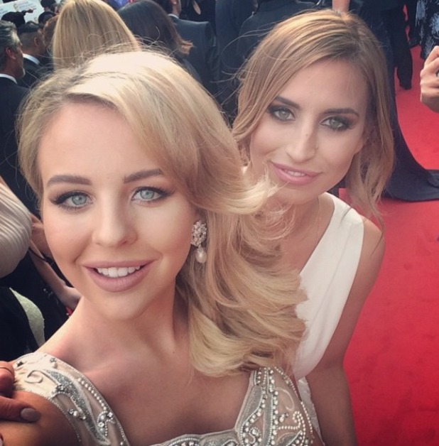 Lydia Bright and Ferne McCann pose on the red carpet at the House of Fraser British Academy (BAFTA) Television Awards, 10 May 2015