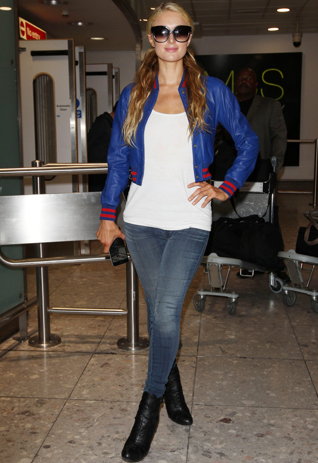 Paris Hilton lands at Heathrow Airport in London to promote her new fragrance and single 12th May 2015