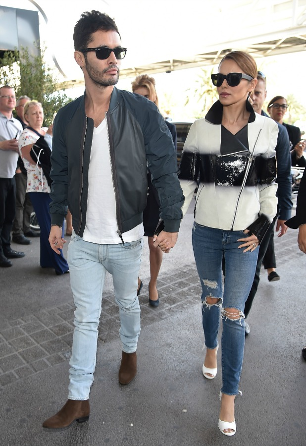 Jean-Bernard Fernandez-Versini and wife Cheryl Fernandez-Versini are seen at Nice airport during the 68th annual Cannes Film Festival on May 16, 2015 in Cannes, France.