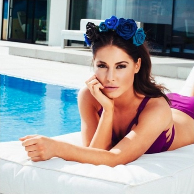 Louise Thompson posed by pool wearing a Loving Alice floral headband, 24 May 2015
