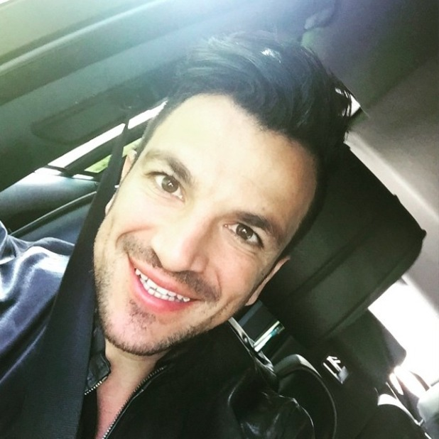 Peter Andre sure looks happy about something! 22 May 2015