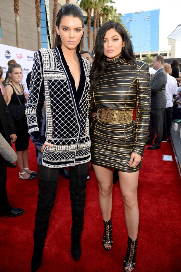 Kendall Jenner (L), wearing Balmain x H&M, and Kylie Jenner attend the 2015 Billboard Music Awards at MGM Grand Garden Arena on May 17, 2015 in Las Vegas, Nevada. (Photo by Kevin Mazur/BMA2015/WireImage)