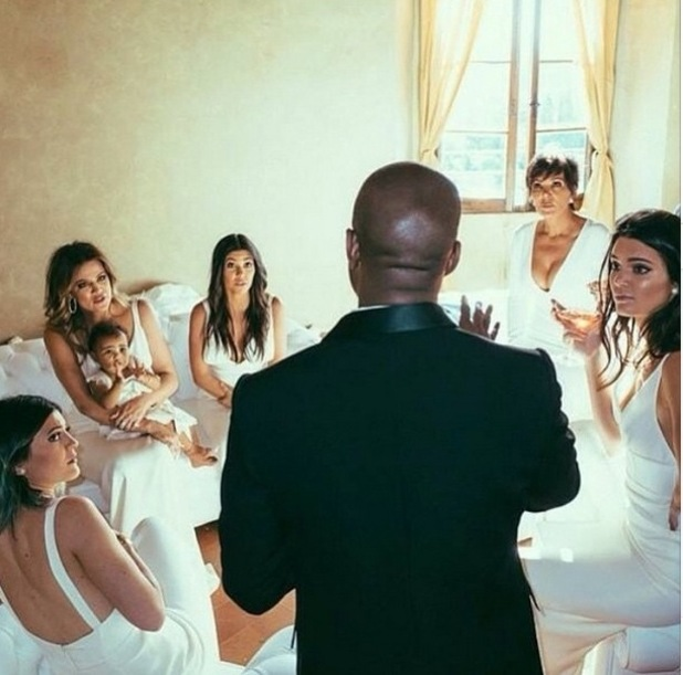 Kris Jenner shares a snap of Kanye West talks to the Kardashian clan ahead of his wedding to Kim, May 2015
