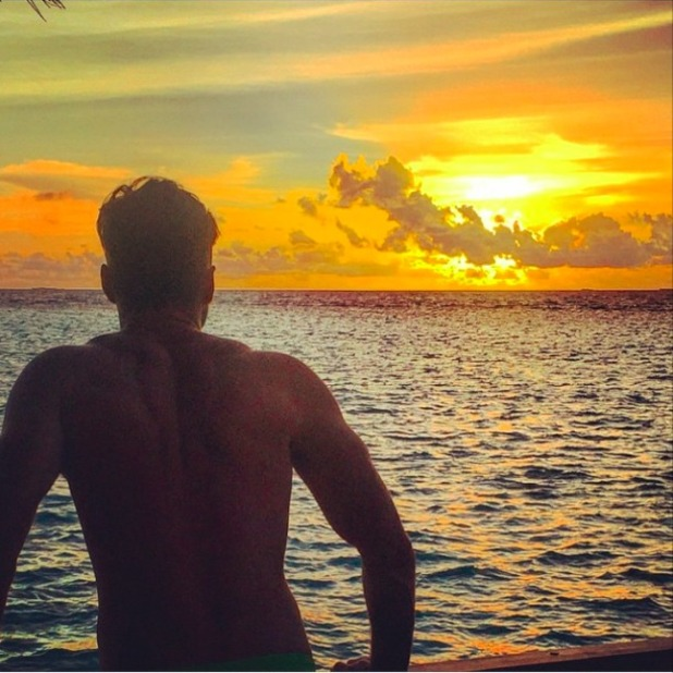 Mark Wright poses infront of sunset on honeymoon in Maldives, 30 May 2015