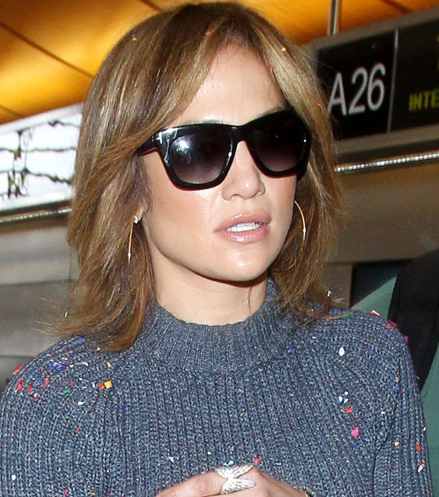 Jennifer Lopez, J.Lo gets confetti bombed/showered with confetti at LAX Airport in Los Angeles 27th May 2015