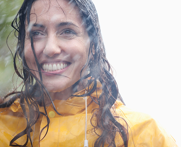 MODEL RELEASED - Smiling woman in rain 2013