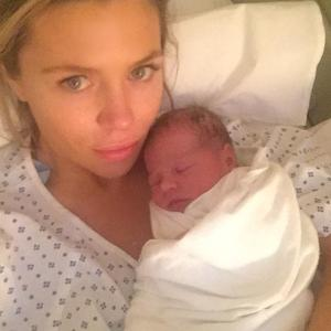 Abbey Clancy announces birth of baby daughter Liberty Rose and shares first pic - 2 June.