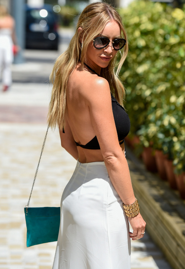 TOWIE's Lauren Pope in monochrome outfit on her way to meet the rest of her cast-members in Marbella/Marbs 5th June 2015
