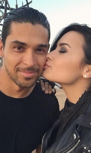 Demi Lovato plants kiss on boyfriend Wilmer Valderrama 9 June