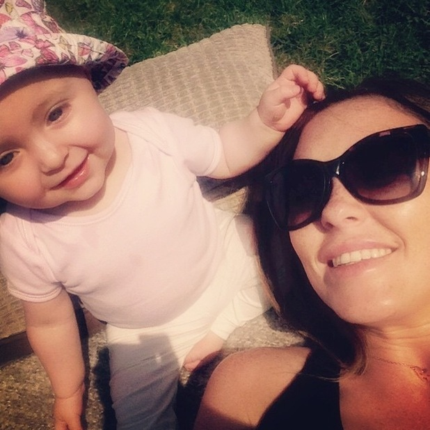 Natasha Hamilton enjoys the sunshine with her daughter Ella - 11 June 2015.