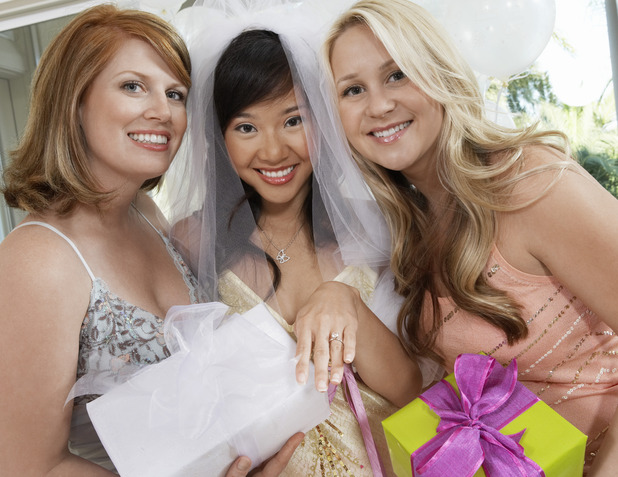 Wedding guests present the bride with presents. Average wedding now costs guests £640