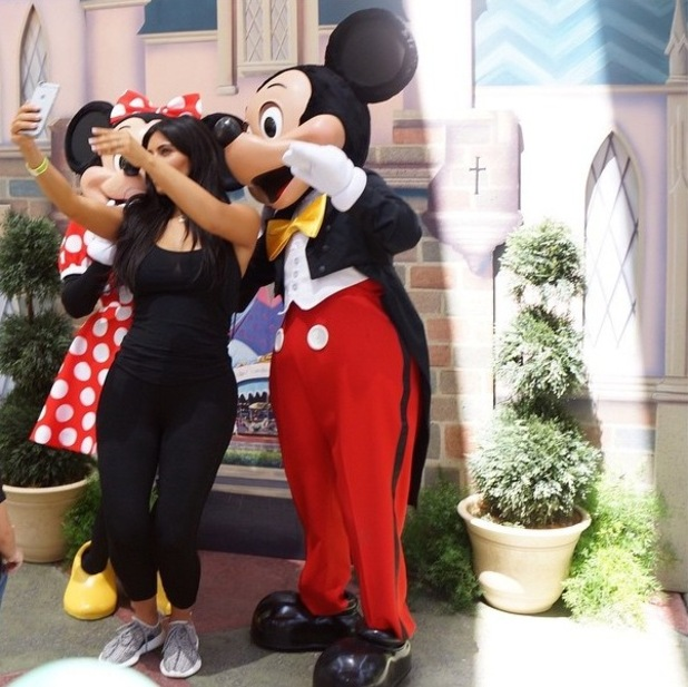 Kim Kardashian poses with iconic Disney characters Mickey and Minnie Mouse at North's birthday party - 17 June 2015.