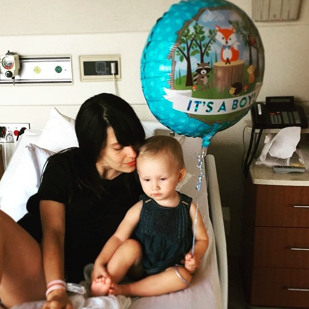 Hilaria Baldwin has a cuddle with daughter just hours after giving birth to son Raphael, 19 June 2015