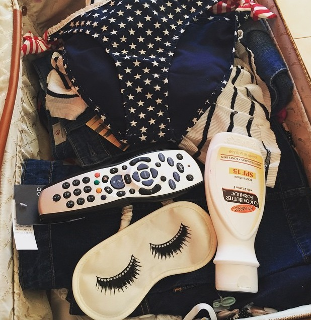 Caroline Flack shows off her luggage, including Palmer's Cocoa Butter SPF15, while in Majorca, filming Love Island, 17 June 2015