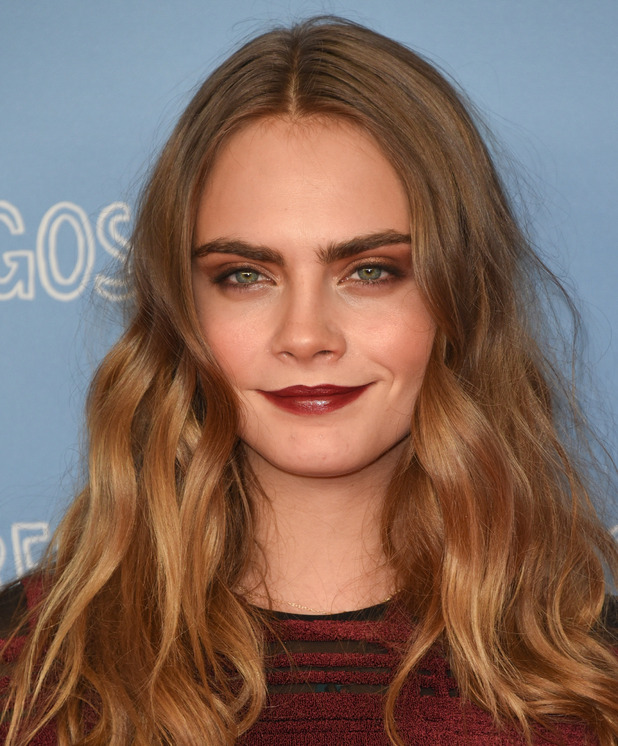 Model Cara Delevingne on the red carpet at the Paper Towns photocall in Berlin bronzed make-up, Germany 17th June 2015