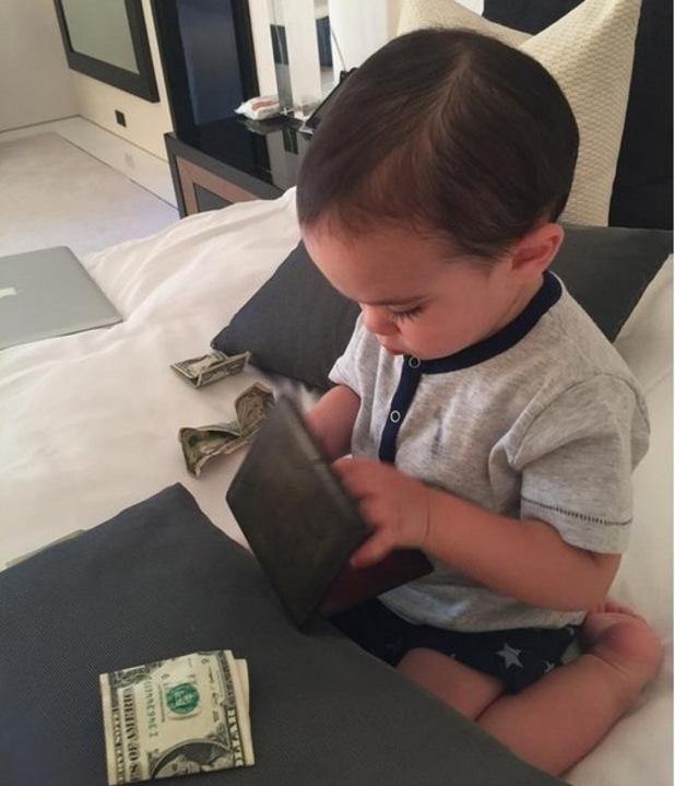 Simon Cowell shares a photo of son Eric to mark Fathers Day, 22nd June 2015
