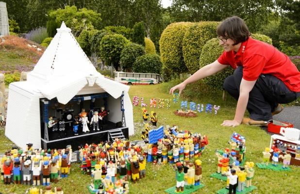 Model maker Hannah Reed puts the finishing touches to the new Glastonbury festival scene at the LEGOLAND Windsor Resort. 22 Jun 2015