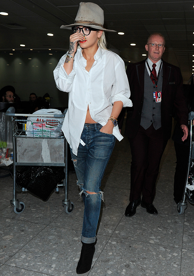 Rita Ora appears worn out, as she makes her way through Heathrow Airport, having flown from New York