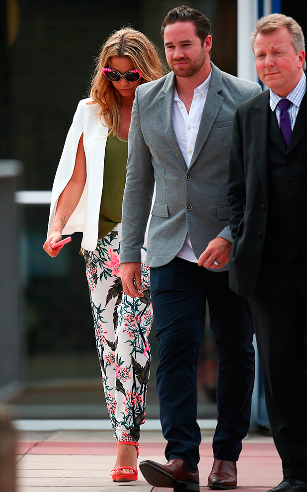 Katie Price leaves Horsham Magistrates' Court, accompanied by her husband Kieran Hayler and her lawyer 3 July 2015
