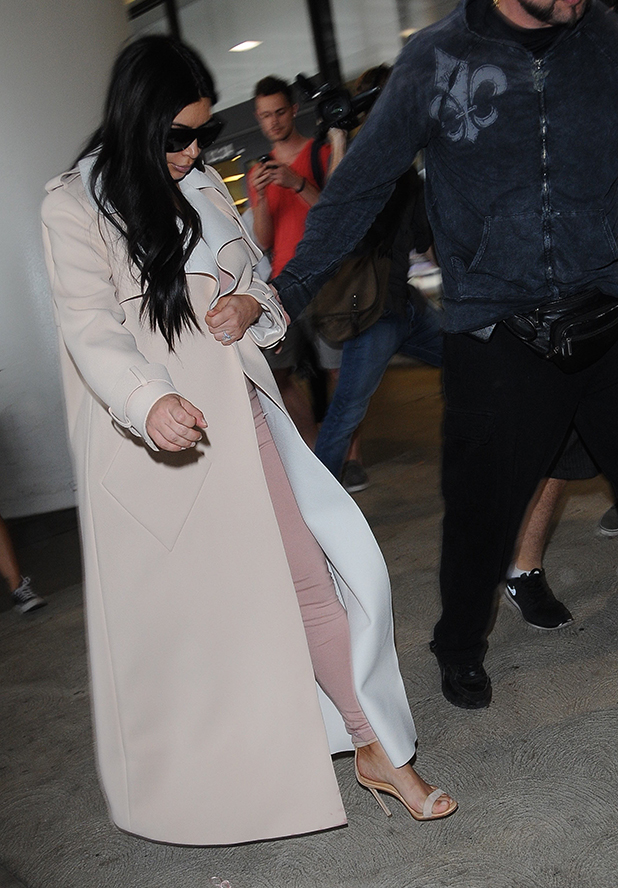 Kim Kardashian is seen out and about arriving at LAX on June 29, 2015 in Los Angeles, California. (Photo by HEV/BuzzFoto via Getty Images)