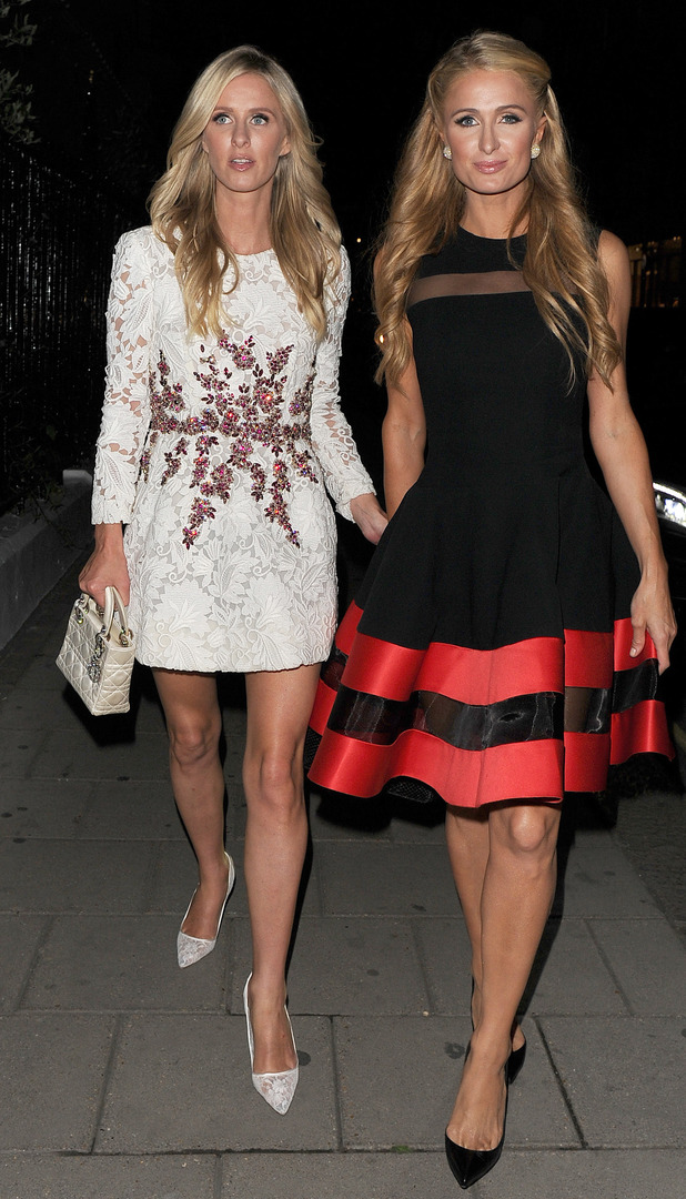 Paris Hilton poses with sister Nicky Hilton outside Claridges in London, 9th July 2015