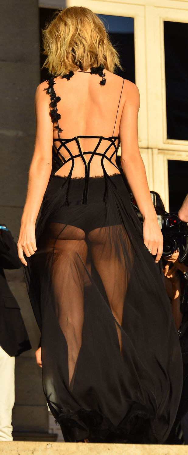 Rosie Huntington-Whiteley at the Atelier Versace Haute Couture show in Paris, dress from behind,, Paris Fashion Week 6th July 2015