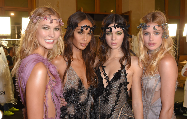 Kendall Jenner, Karlie Kloss, Joan Smalls and Doutzen Kroes pose for the camera at the Paris Fashion Week Atelier Versace Show 6th July 2015
