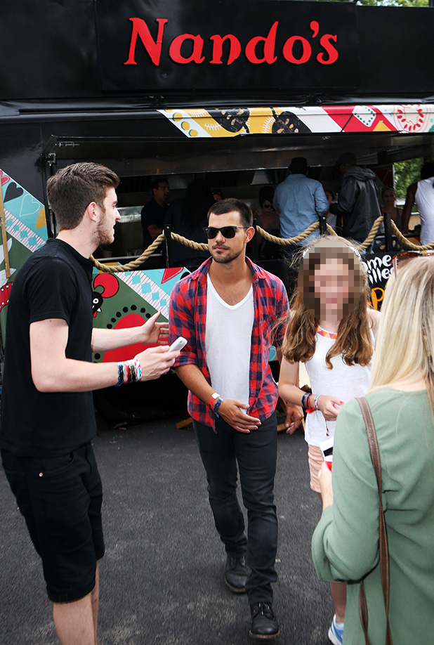 Taylor Lautner by the Cock o' Van backstage at the New Look Wireless Festival today. 5 Jul 2015