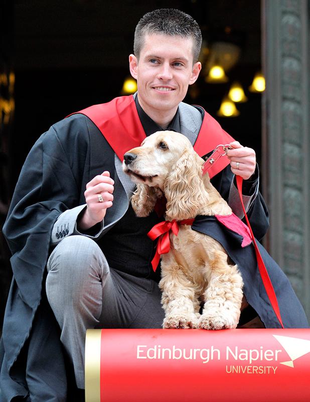 Jack Proctor and cocker spaniel Fudge wearing their graduation robes 7 Jul 2015