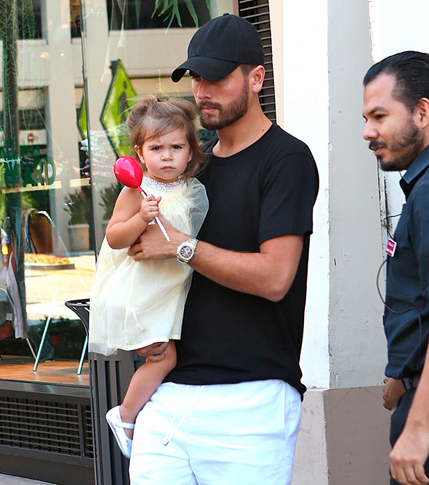 Kourtney Kardashian leaves the American Girl Party at The Grove with her partner Scott Disick and their two children, Mason and Penelope