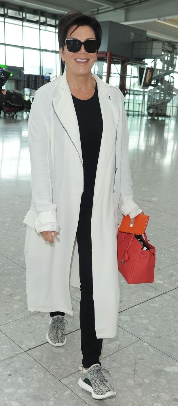 Kris Jenner at Heathrow Airport in London in white duster jacket 14th July 2015