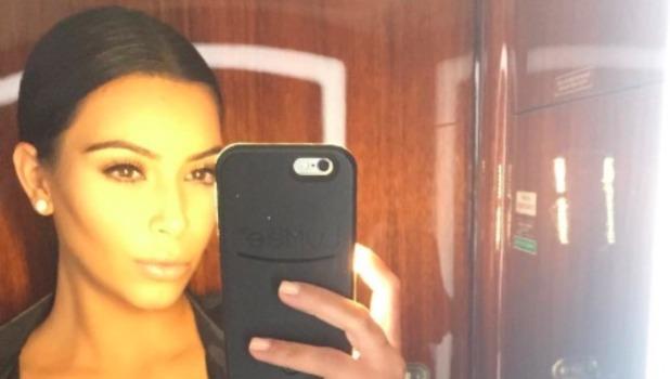 Kim Kardashian shows off cleavage in aeroplane selfie, 18 July 2015
