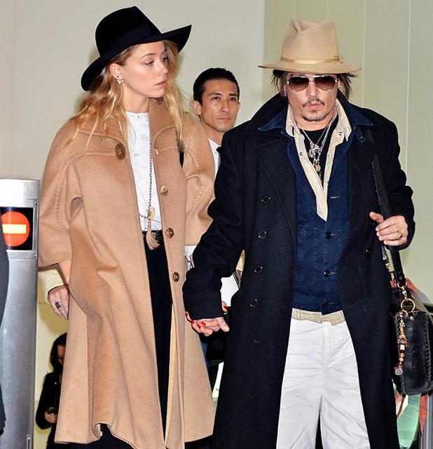 Johnny Depp and Amber Heard arrive at Haneda Airport 26 January 2015
