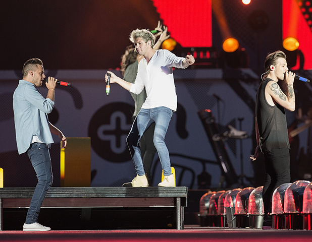 Louis Tomlinson of One Direction performs on stage at Century Link Field on July 15, 2015 in Seattle, Washington.